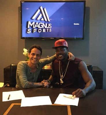 Marc Anthony and Aroldis Chapman at Magnus Media and Magnus Sports headquarters in Miami during 360 deal signing (Photo credit: Magnus Media)
