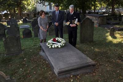 As part of today's commemorative activities, Cunard paid tribute to the legacy of Samuel Cunard and wife, Susan, by laying a wreath on Suan's gravesite. Pictured: Captain Kevin Oprey, Master of Queen Mary 2, Cunard historian John Langley, and Cunard Public Relations Director Jackie Chase.