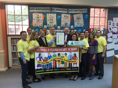 Stamford Mayor David Martin hand delivers Mayoral Proclamation to Stamford Office Managing Partner  Bud McDonald and EY Team volunteering for Junior Achievement