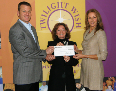 Keith Maddox, of Parentgiving, Presents Check to Cass Forkin and Sandy Guinan of Twilight Wish Foundation. (PRNewsFoto/Twilight Wish Foundation; Parentgiving) (PRNewsFoto/TWILIGHT WISH FOUNDATION)