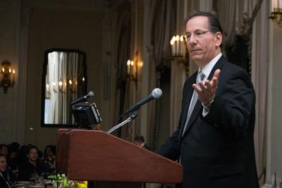 Dr. Alan Penzias receives his award at Illuminations NYC. (PRNewsFoto/The American Fertility Association)