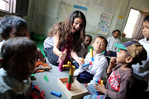 UNICEF Ambassador, Selena Gomez visits an early childhood education classroom at the child-friendly Satbariya Rapti Secondary School where she witnessed their safe, interactive, creative and fun learning environment. Photo Credit: Courtesy of U.S. Fund for UNICEF/Josh Estey/MataHati (PRNewsFoto/U.S. Fund for UNICEF, Josh Estey/MataHati)