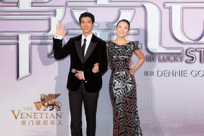 """Superstars Zhang Ziyi (right) and Wang Leehom (left) walk the red carpet at The Venetian Macao Sept. 12, for a gala premiere of their new romantic comedy, """"My Lucky Star.""""   (PRNewsFoto/Sands China Ltd.)"""