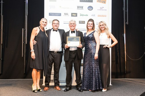Badgemaster Manufacturing Manager Scott Warren with Managing Director John Bancroft MBE and Customer Services Advisor Amy Dench receive the Best IT Innovation and Website award from Olympic star and TV presenter Sharron Davies. (PRNewsFoto/Badgemaster)