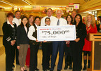 Stater Bros. President and COO, Pete Van Helden (center) presents a $75,000 check for the Geriatrics Department at City of Hope to Dr. Arti Hurria (right), Associate Professor of Medical Oncology.  The check presentation took place inside the company's supermarket located at 20677 Amar Rd in Walnut.  (PRNewsFoto/Stater Bros. Charities)