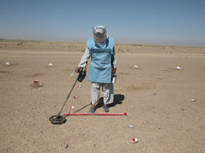 A Sterling Global Operations employee conducts demining operations as part of the Emirates Mine Clearance Program Afghanistan (EMCPA). The humanitarian project funded by the United Arab Emirates resulted in more than 11,000 explosive devices being removed and destroyed.  (PRNewsFoto/Sterling Global Operations)