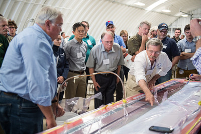Attendees of Composites in Wind participate in a LRTM demo of a nacelle as Jim Noonan, Technical Support Manager, Composites One and Rick Pauer, Applications Manager, Polynt Composites, discuss the advantages that LRTM has to offer those considering converting to closed molding.