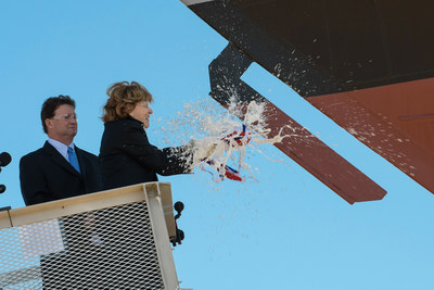 Ship sponsor Kate Lehrer breaks a bottle of champagne across the bow during the christening ceremony for the nation's 13th Littoral Combat Ship, the future USS Wichita, at the Fincantieri Marinette Marine shipyard on Sept. 17.