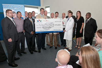 Representatives from Hyundai Hope On Wheels and Baltimore-area Hyundai dealers award the Johns Hopkins Sidney Kimmel Comprehensive Cancer Center, Division of Pediatric Oncology of Baltimore with a $75,000 Hyundai Scholar Grant to Dr. Christopher Gamper for his work on improving immunotherapy against cancer.  (PRNewsFoto/Hyundai Hope on Wheels)