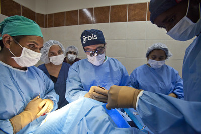 Dr. Marc Cepela, Volunteer Faculty surgeon (middle), performs an oculoplastics procedure alongside his trainees at the Regional Institute of Ophthalmology (IRO) during the 2014 FEH program in Trujillo, Peru. Learn more: orbis.org (photo: Geoff Bugbee/Orbis).