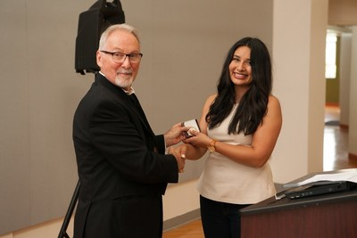 Harpreet Basi, of Sanger, California, receives the prestigious Alpha Rho Chi Medal from Len Zegarski, Chair, Undergraduate Architecture for NewSchool of Architecture & Design in San Diego. Since 1931, the Alpha Rho Chi Medal recognizes graduating architecture students for their leadership and service and for what they have to offer to the future of the profession with the Alpha Rho Chi Medal.