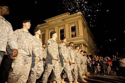 ERA Sarver Real Estate in Leesville, La., recently planned a welcome home ticker tape parade for more than 4,000 Army soldiers returning home to Fort Polk after a tour in Afghanistan. Photo courtesy of ERA Sarver Real Estate.