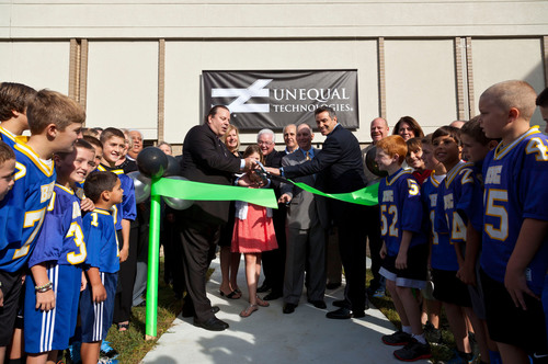 Unequal Technologies opens their new headquarters with Kurt Warner. Left to right: Rob Vito, CEO of Unequal Technologies, Lisa Vito, Julia Vito, William E. Hecht, Chairman of the Board of Alliance Bank, Sen. Dominic Pileggi, Rep. Stephen E. Barrar and Kurt Warner.  (PRNewsFoto/Unequal Technologies)