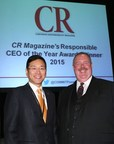 LG Electronics USA CEO William Cho, left, is congratulated by Corporate Responsibility Magazine CEO, Elliot Clark, right, at the Responsible CEO of the Year Award ceremony in New York, N.Y.,Thursday, October 22, 2015. (Stuart Ramson/AP Images for LG Electronics USA)