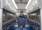 Chris McLaren inside his milking parlor using Afimilk Herd Management System