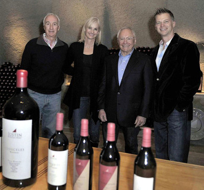(From left) Justin and Deborah Baldwin, Founders of JUSTIN Vineyards & Winery along with Chairman of Roll International, Stewart Resnick and FIJI Water President and COO, John Cochran, celebrating FIJI Water's acquisition of JUSTIN Vineyards & Winery in Paso Robles, California on December 6, 2010.  (PRNewsFoto/FIJI Water, Phil Klein)