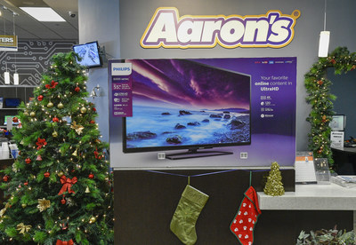"IMAGE DISTRIBUTED FOR AARON'S, INC. - Aaron's kicked off a week-long Black Friday celebration today by surprising loyal customers in Atlanta, Ga., Jacksonville, Fla., Memphis, Tenn. and Nashville, Tenn. with free 55"" Phillips Smart 4K UHD LED TVs on Monday, Nov. 21, 2016. (John Amis/AP Images for Aaron's, Inc.)"
