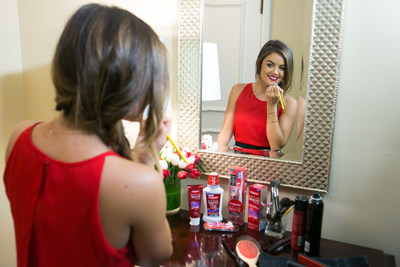 Lucy Hale getting red carpet ready with Colgate Optic White. (PRNewsFoto/Colgate-Palmolive)