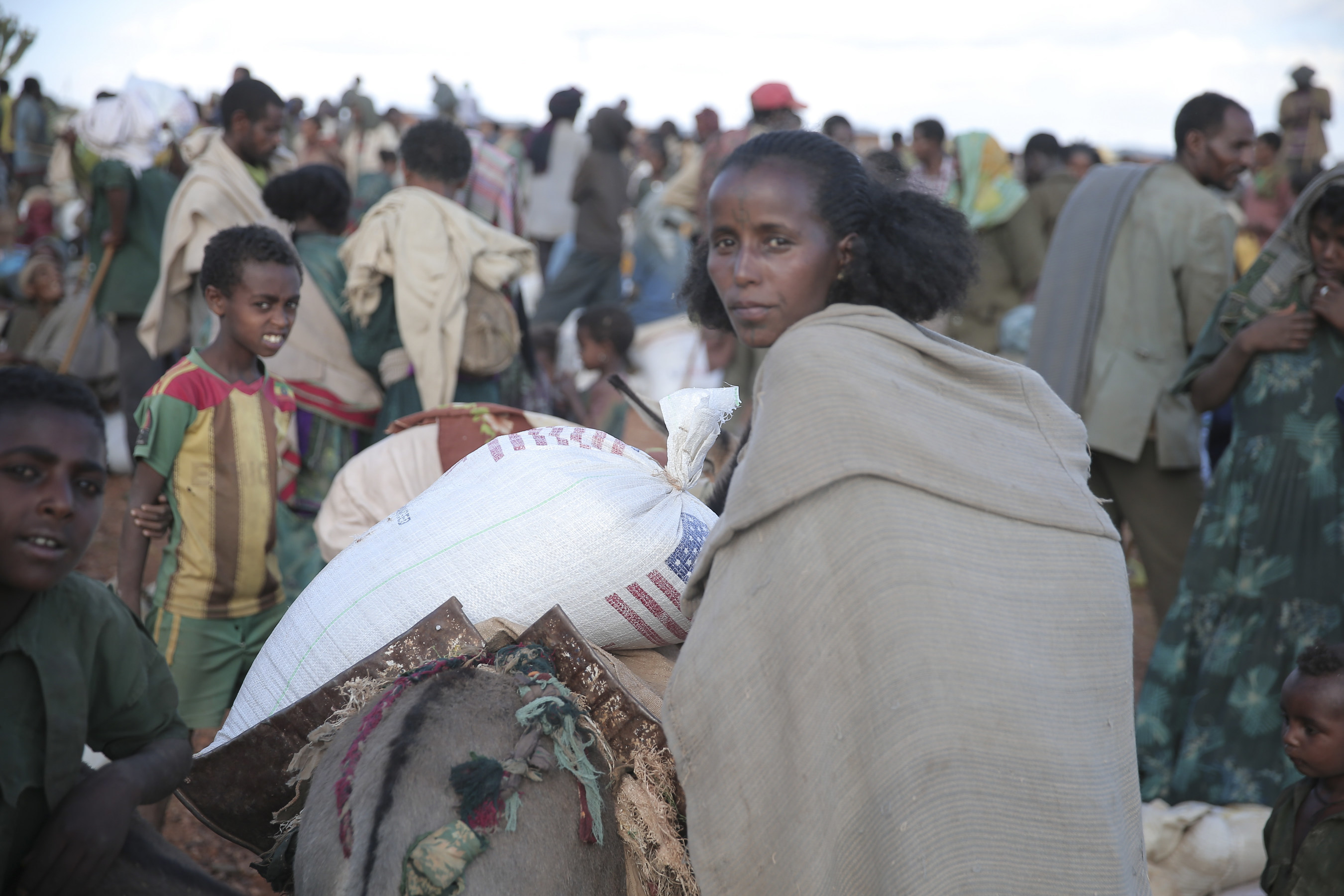 An emergency food aid distribution in the Amhara Region of Ethiopia. Save the Children, in partnership with the Organization for Rehabilitation and Development in Amhara (ORDA), is leading the distribution of the food aid for this site.
