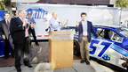 NASCAR driver Austin Theriault (far right) unveiled the new Maine race car in Portland and Bangor, ME alongside Maine's Governor Paul Lepage (left). Photo Credit: Tim Greenway. (PRNewsFoto/Austin Theriault Racing)