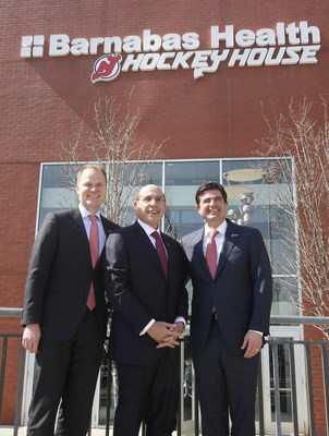(L-R) Hugh Weber, President, Prudential Center and New Jersey Devils; Barry H. Ostrowsky, President and CEO, Barnabas Health; and Scott O'Neil, CEO, Prudential Center and New Jersey Devils stand outside the newly named Barnabas Health Hockey House at Prudential Center. Prudential Center and the Devils announced Barnabas Health as Official Health Care Partner and first Marquee Partner of the arena and team. The Barnabas Health Hockey House is the hub of New Jersey youth and grassroots programming.