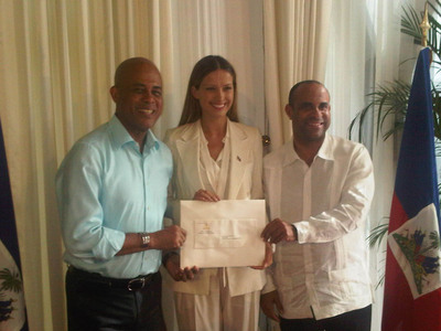 President of the Republic of Haiti Michel Martelly (left) appointed Petra Nemcova, founder and chairwoman of nonprofit organization Happy Hearts Fund, as ambassador at large for Haiti at a special ceremony at the national palace in Port-au-Prince, Haiti, Friday, June 8, 2012, in the presence of Prime Minister Laurent Lamothe.  (PRNewsFoto/Happy Hearts Fund (HHF))