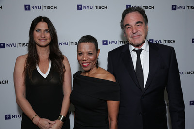 """Outstanding Achievement in Development"" honoree, Liza Chasin; NYU Tisch's Dean Mary Schmidt Campbell and ""Outstanding Achievement in Cinematic Arts"" honoree, Oliver Stone at the NYU's Tisch School of the Arts Scene Change: LA Benefit Gala at the Beverly Wilshire.  (PRNewsFoto/NYU Tisch School of the Arts)"