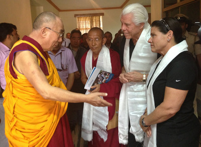 The Dalai Lama blesses Bill and Tani Austin, founders of Starkey Hearing Foundation, as Lama Guru Gyaltsen looks on.  (PRNewsFoto/Starkey Hearing Foundation)