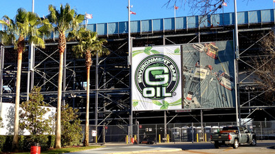 G-OIL, America's first and only bio-based fully synthetic motor oil to receive American Petroleum Institute certification, made history again at Daytona International Speedway as the G-OIL flag was officially raised above the iconic 2.5 mile tri-oval superspeedway for the first time yesterday morning, February 17.  (PRNewsFoto/Green Earth Technologies)