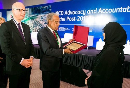 "Her Highness Sheikha Jawaher Al Qasimi receiving ""Sharjah Declaration"" from Sir George Alleyne and Dr ..."