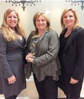 Monica C. Smith, Marketsmith, Inc. founder & Chairwoman and i.Predictus CEO, accepts the 2014 NJTC Impact Company of the Year Award along with i.Predictus GM Nancy Gallo (left) and Marketsmith President Jill Draper (right).