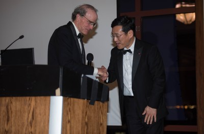 Laurance Rockefeller, President, American Conservation Association (left) congratulates William Cho, President and CEO, LG Electronics USA, as LG's Englewood Cliffs building project is honored by USGBC NJ.