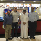 """Celebrating the opening of the first Chester's at the Al Othaim mall in Riyadh, Saudi Arabia are (left to right), Rick Davis (Chester's VP of Systems Management), Abdulraouf Alhafez (Regional Marketing Manager of Othaim Real Estate), Abdullah A. Al Hamad (General Manager at Othaim), and Jamal """"Jimmy"""" Nasir (Chester's Area Director)."""