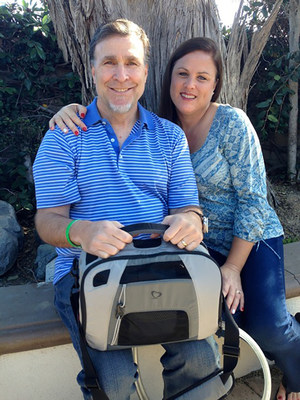 SynCardia Total Artificial Heart patient Steve Williams and his wife, Mary, share a happy moment on Thanksgiving. The Freedom portable driver that powers his SynCardia Heart is on his lap.