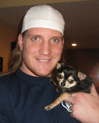 "Enough is enough! That's the message from professional football champ and proud small dog owner A.J. Hawk, who is teaming up with Mighty Dog(R) to help prove that small dogs and the people who own them defy stereotypes. Hawk is inviting guy's guys across the country to enter the Mighty Dog(R) ""Big Guy, Small Dog"" Contest (www.mightydog.com) to help change the misperceptions.  (PRNewsFoto/Nestle Purina PetCare Company)"