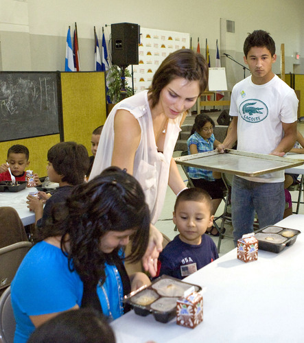 Katharine McPhee, a former American idol runner-up, distributed meals to children at LINC Houston, a feeding ...