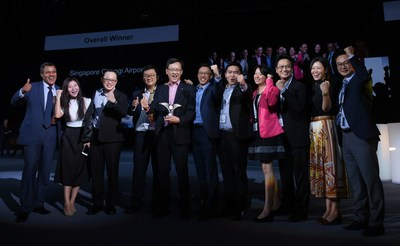 Adrian Newton, group director at UBM EMEA (left) with the Singapore Changi Airport team. (PRNewsFoto/Routes)