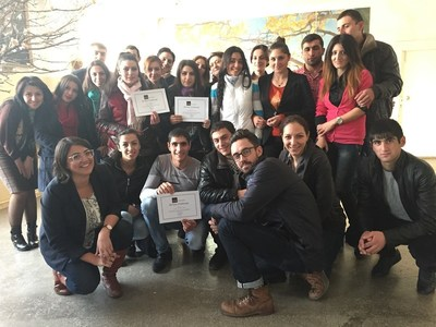 Woodbury's Ani and Jason, kneeling left and right, join with Impact Hub Yerevan