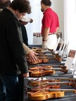 Makers and musicians compare violins at the Contemporary Violin Exhibition in New York taking place in Oct. 18-20.