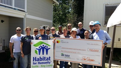 Renton City Councilmember Don Persson joins AT&T and Habitat for Humanity Seattle volunteers for a donation supporting the construction of a 9-unit multi-unit building for local families in need of a home. (PRNewsFoto/AT&T Inc.)
