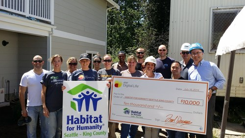 Renton City Councilmember Don Persson joins AT&T and Habitat for Humanity Seattle volunteers for a donation ...