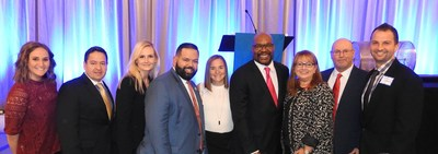 Combined Insurance representatives join Chicago ABC7 anchor Hosea Sanders and 2016 Paralympic Medalist and Army war hero Melissa Stockwell at the Better Business Bureau of Chicago and Northern Illinois' 2017 Torch Awards for Marketplace Ethics on December 1, 2016. From left: Ryan Dickey; Dennis Ontaneda, a BBB board member; Melanie Lundberg; Miguel Torres; Melissa Stockwell; Hosea Sanders; Wilmi Schmidt; Patrick McCullough; Szymon Latawiec