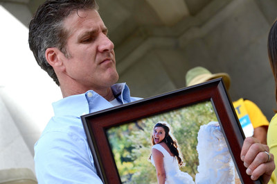 Dan Diaz holding photo of his wife, Brittany Maynard, who moved to Oregon to utilize its death-with-dignity law and inspired the passage of Calif. End of Life Option Act