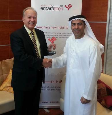 Mark Clifton, vice president, Products and Services Division at SRI International (left) with Thani Alzaffin, director general and board member of emaratech. (PRNewsFoto/SRI International)