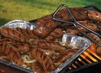 It's not a sausage fest without a Brat Hot Tub and it's an easy way to serve a variety of fresh or smoked brats to a hungry crowd. Simply put a large tin or aluminum pan on the grill, pour your favorite beer into the tin, add butter, onions, and the grilled brats. Any remaining brats can be left in the hot tub to soak up even more flavor for late party or tailgate stragglers. (PRNewsFoto/Johnsonville Sausage, LLC)