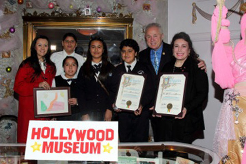 Donelle Dadigan and Dolores Mission School Children. (PRNewsFoto/The Hollywood Museum) (PRNewsFoto/THE HOLLYWOOD MUSEUM)