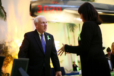 County of San Diego Supervisor Ron Roberts, 4th District, visits with a guest at *Serving Those Who Serve: Wellness Fair for Veterans, Active Duty and their Families* at the San Diego Air & Space Museum on March 4 in San Diego, Calif. Hosted by the California Mental Health Services Authority, County of San Diego Health and Human Services Agency and the National Alliance on Mental Illness San Diego, the event supports mental health awareness and stigma elimination in San Diego's military community.