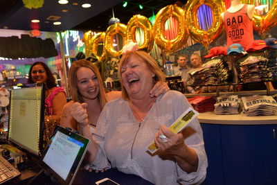 Pamella Siegel, pictured with her granddaughter Emilie Wagy, reacts to finding out she was randomly selected as SlotZilla's Month of the Millionth Flyer Grand Prize Winner. Siegel received $1,000, a year of free flights on the SlotZilla, a plaque, and special recognition from Las Vegas Mayor Carolyn G. Goodman. She was visiting Las Vegas from the Sacramento area to celebrate her 65th Birthday. For more information on SlotZilla visit www.vegasexperience.com.