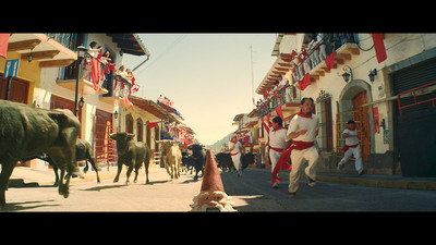 In his latest ad campaign the Travelocity Roaming Gnome is dropped into a scene from the world famous running of the bulls in Pamplona, Spain.