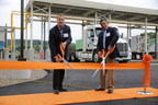 Direct Energy Business President John Schultz (left) and John Nahill, CEO of XNG, cut the ribbon at the new Manheim CNG Center in upstate New York. Direct Energy and XNG partnered to bring this first-of-its-kind facility to the area.